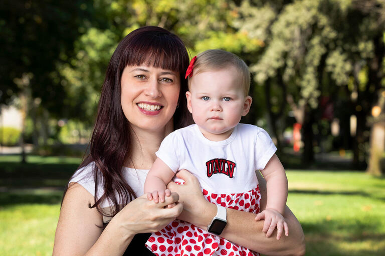 Janine Barrett poses with her 10-month-old daughter, Makenzie on campus.