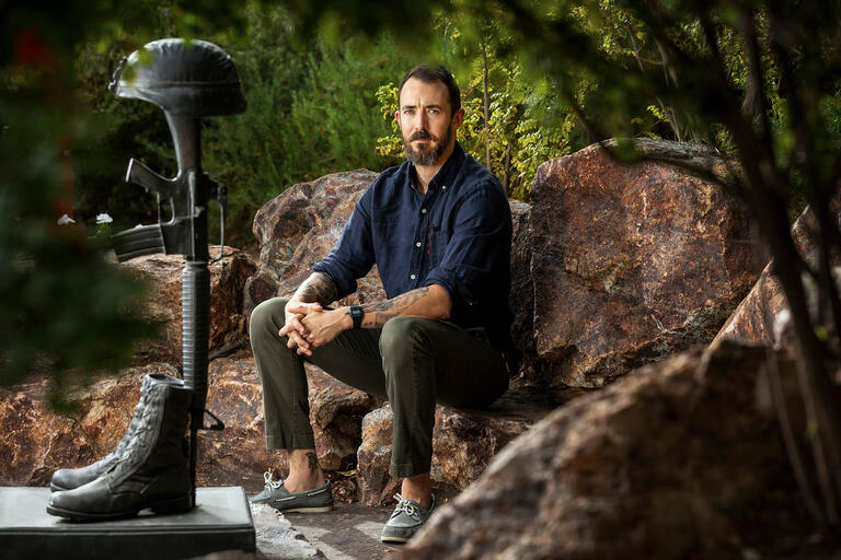 Nicholas Barr poses on UNLV's campus, his work focuses on homeless young adults and military service members.