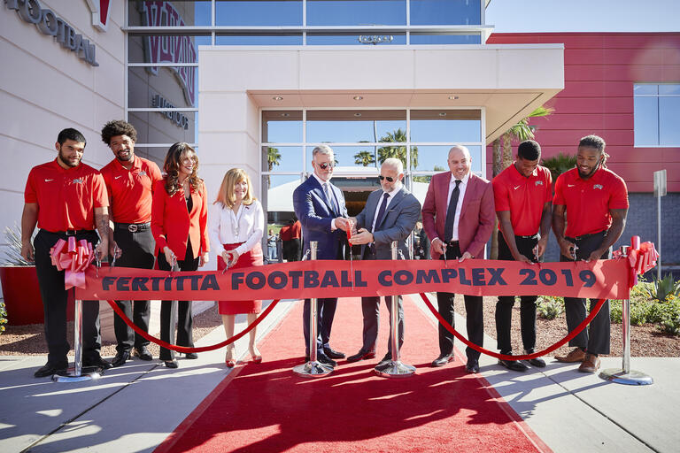 People preparing to cut ribbon on new Fertitta Complex