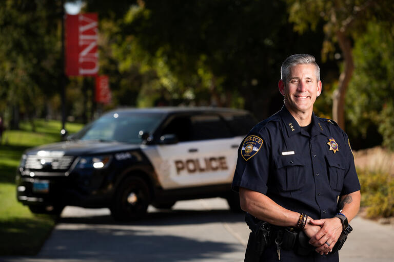 Police Services Assistant Chief Tod Miller poses in front of his cruiser on UNLV's campus.