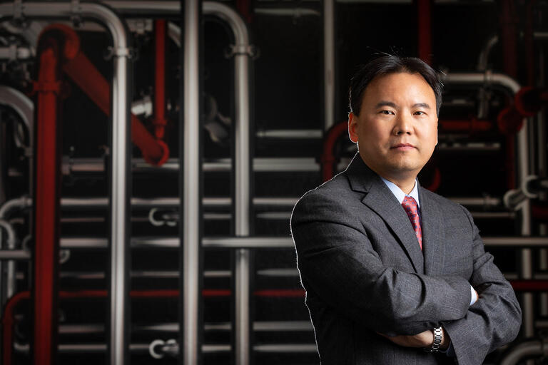 Yong Li poses for a photograph on UNLV's campus.