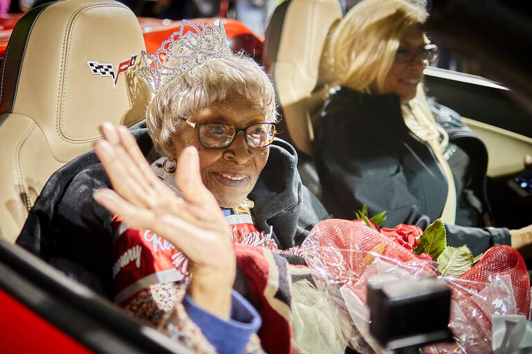Audrey James rides in the first car in the Homecoming Parade.