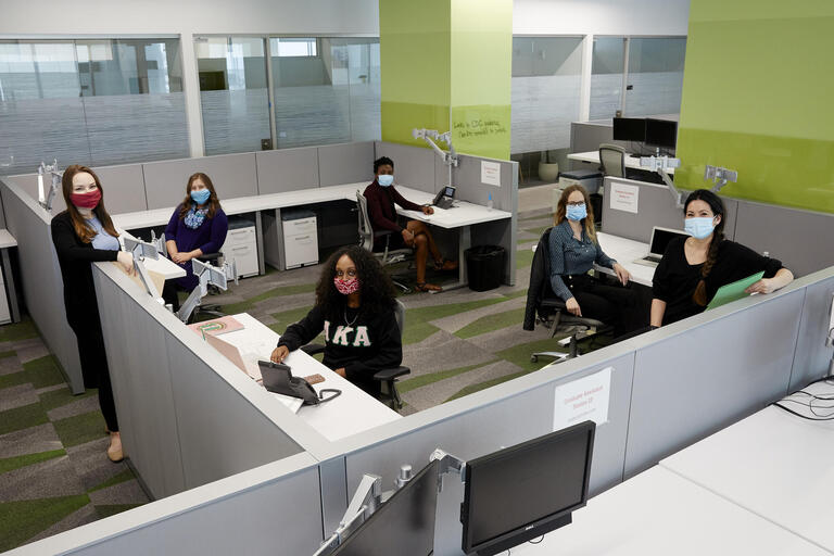UNLV student contact tracing team seated in office space