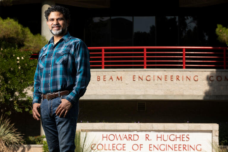 Haroon Stephen stands in front of the Engineering Complex.