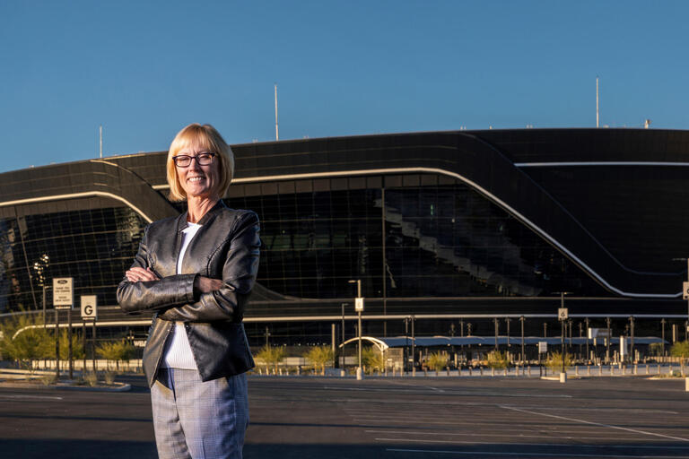 Professor Nancy Lough standing in front of Allegiant Stadium in Las Vegas