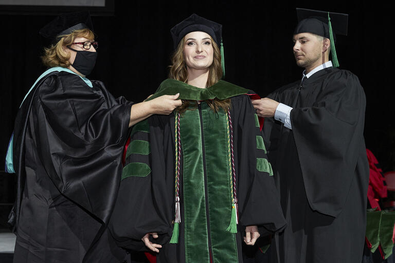 woman in doctoral hood ceremony