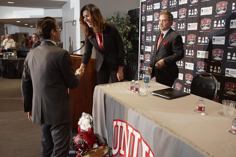 Desiree Reed-Francois shakes hands
