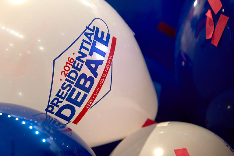 baloons with debate logo