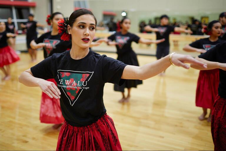 A woman practices Hawaiian dance
