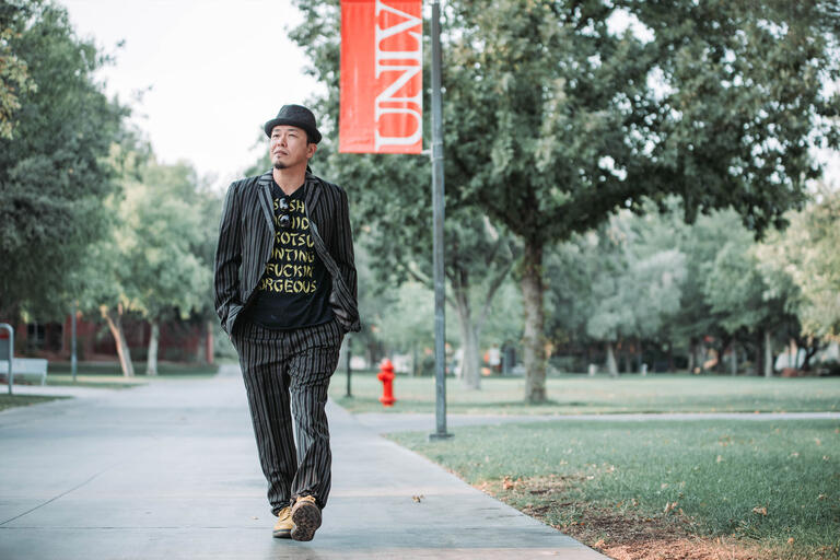 A man walks along the UNLV campus