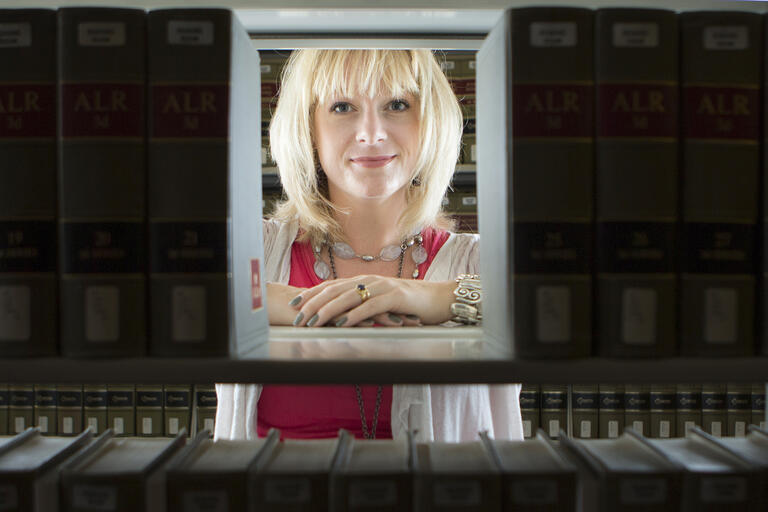 Woman framed by books