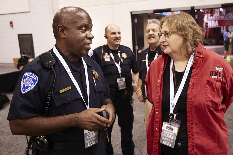 UNLV Police Lt. Jeff Green and Lori Temple, vice provost for information technology, discuss Presidential Debate security