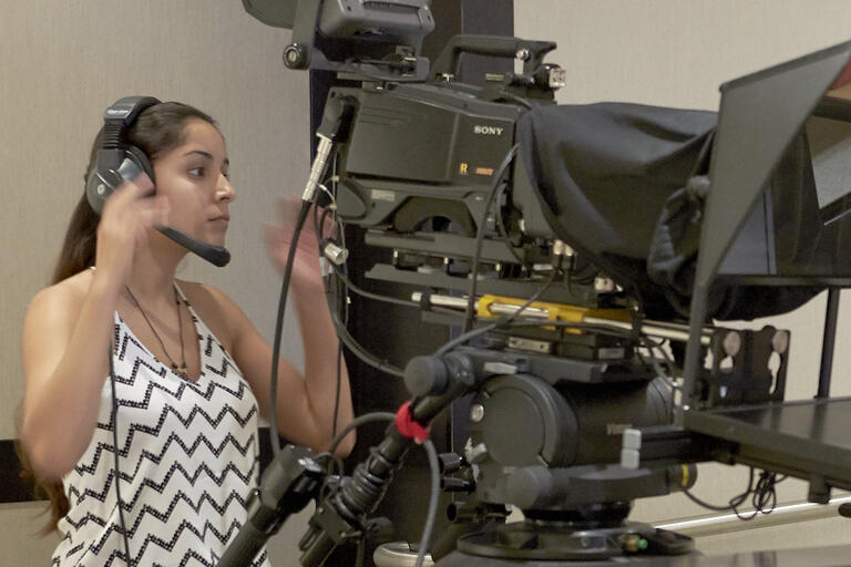 Student operating a tv camera