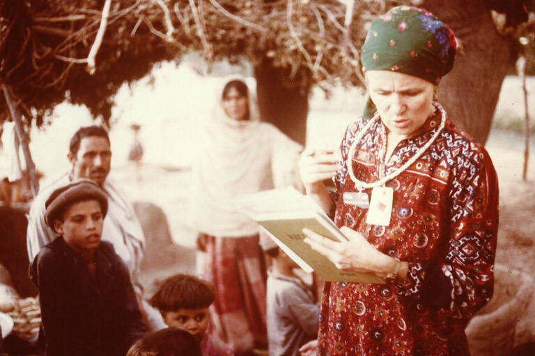 Mary Guinan, in traditional dress in an Afghan refugee camp