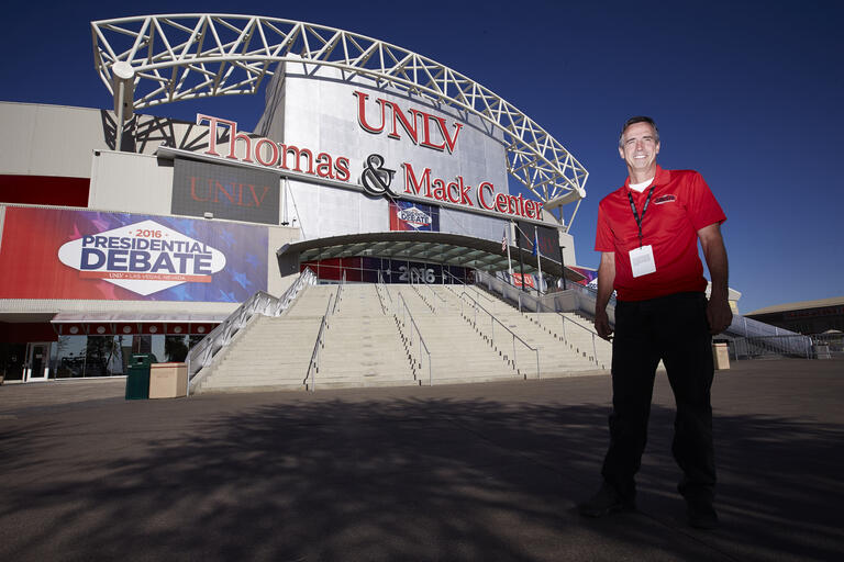 Kurt Hoff poses in fromt of the Thomas and Mack
