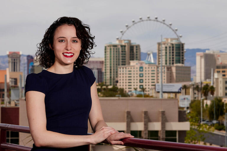 A portrait of Shekinah Hoffman with a portion of the Las Vegas skyline, including the High Roller, in the background.