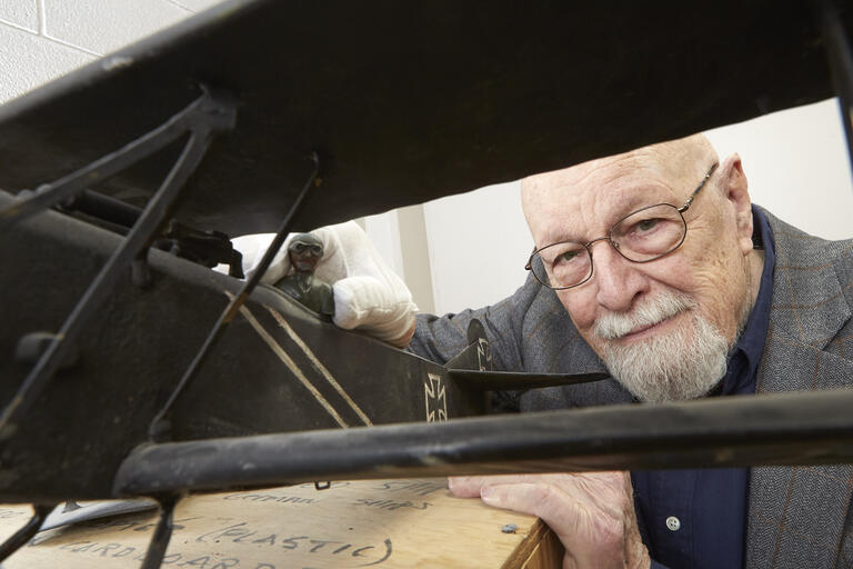 Hart Wegner look at a model plane
