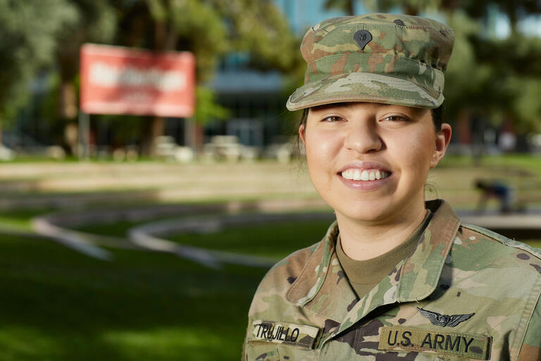 A woman in an Army uniform smiles