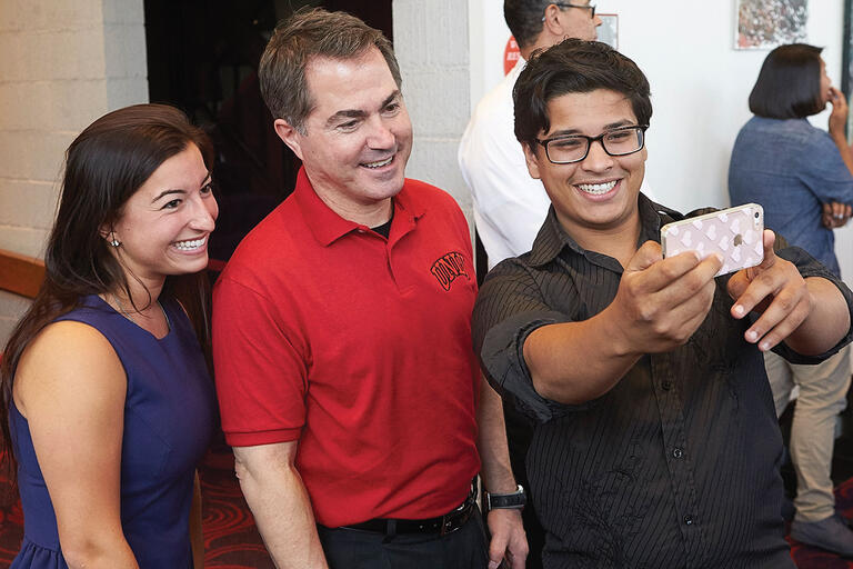Len Jessup takes time for a selfie with this year's student body Vice President Kanani Espinoza and President Elias Benjelloun at a May 5 event.