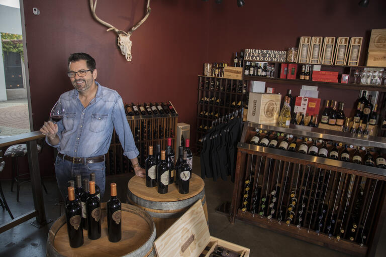 man in wine shop