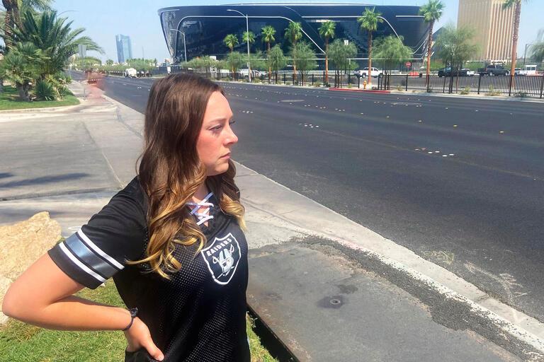 A woman stands near Allegiant Stadium
