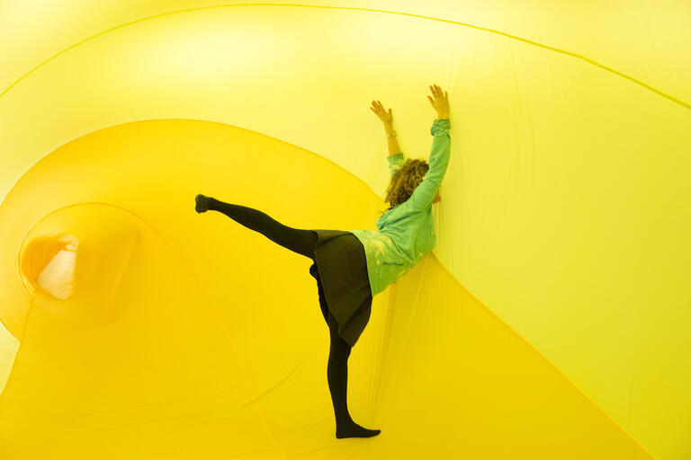 female dancer surrounded by yellow material