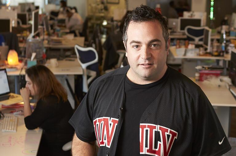 man in UNLV jersey