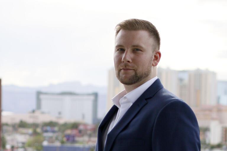 man in front of Las Vegas Strip