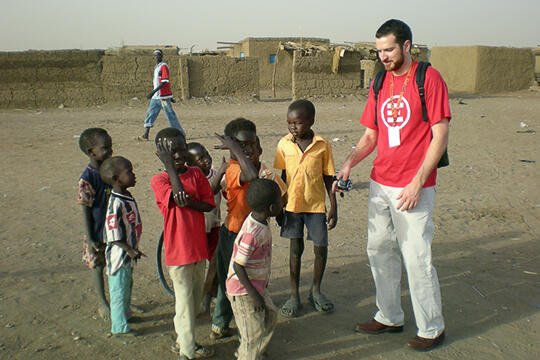 Eric Talbert with a group of children