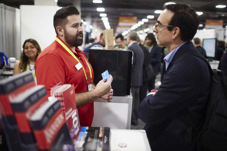 two men in talking at trade show