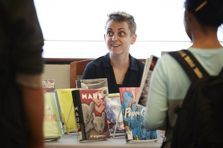 woman at display of children's books