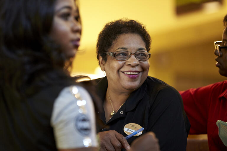 UNLV Dining Commons cashier Minnie Epps smiles.