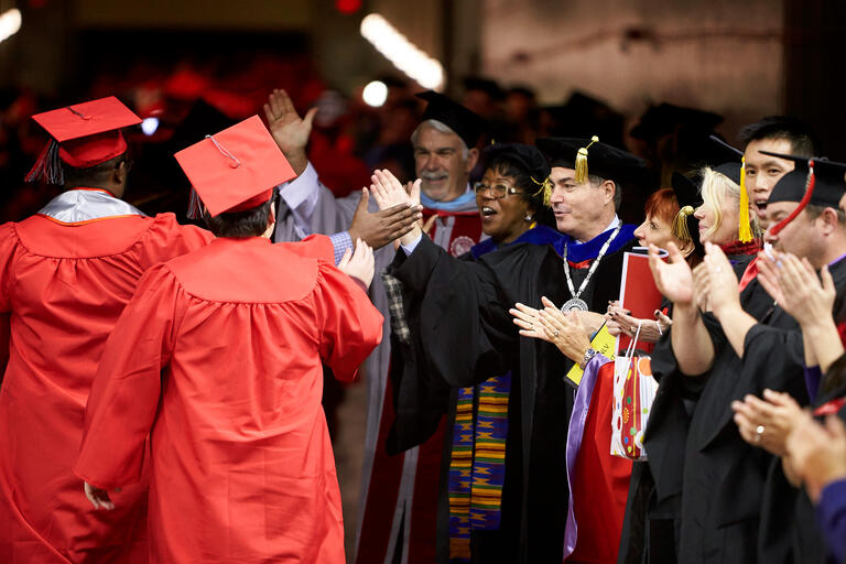 Students and UNLV staff celebrating at graduation.