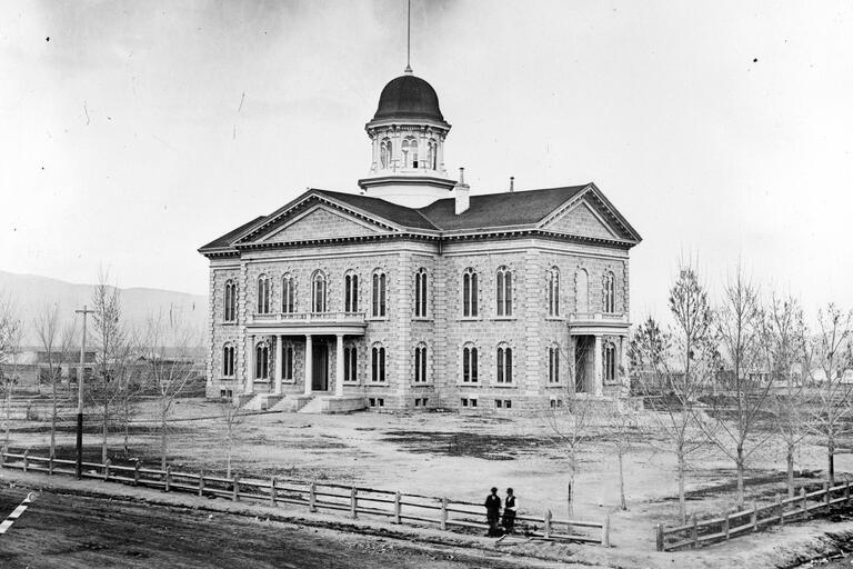 A historical photo shows the original Nevada Capitol
