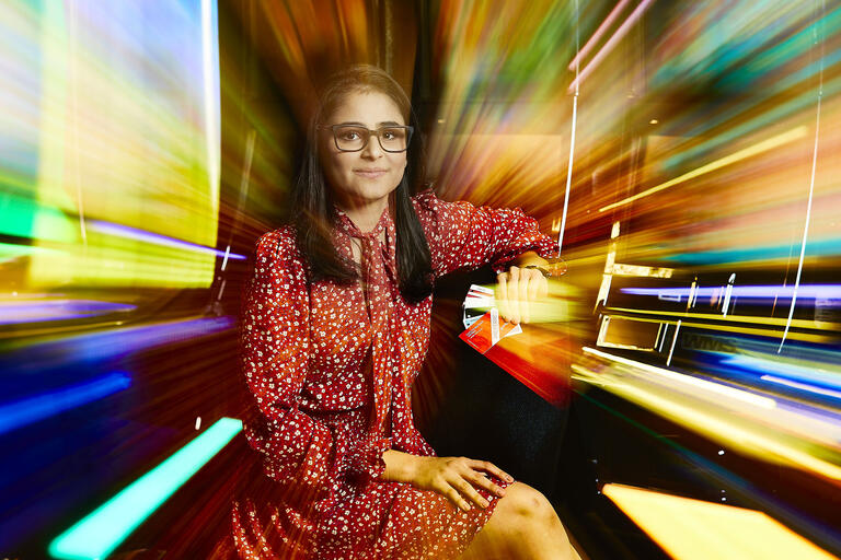 woman with motion blur of color around her