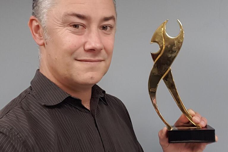 man with award