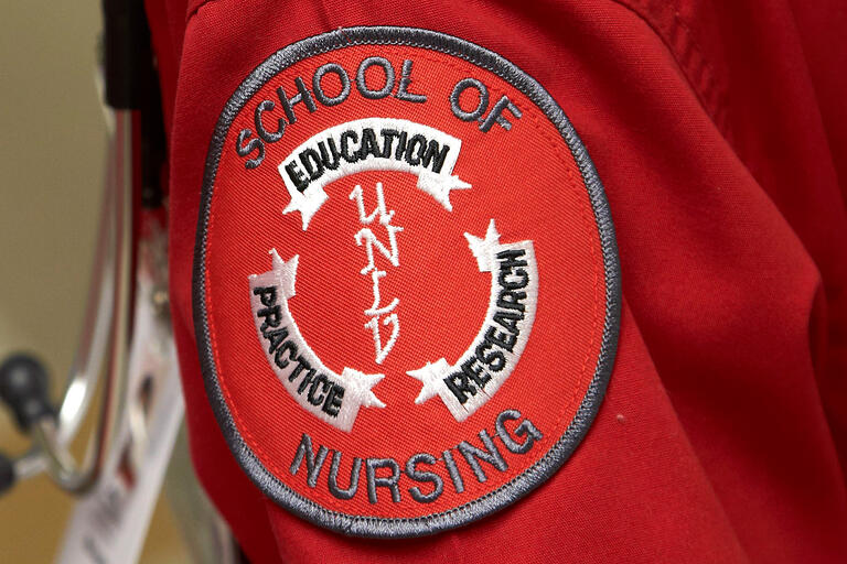 A red patch shows the emblem for the UNLV School of Nursing