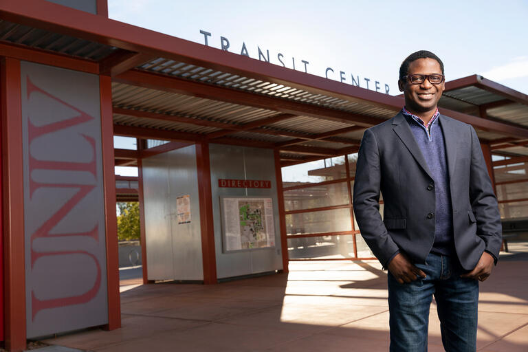 Student John Olawepo stands in front of the UNLV bus station.