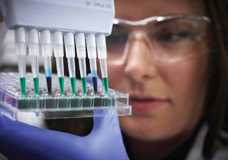 A woman scientist holding vials