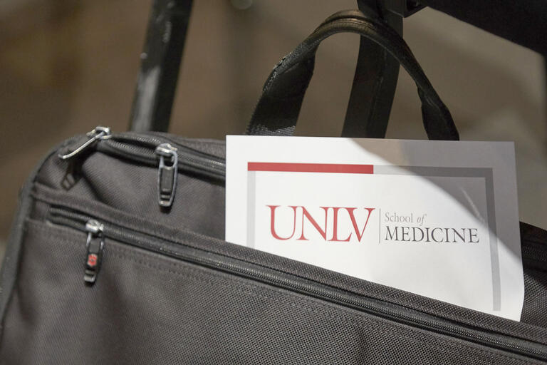 briefcase with UNLV School of Medicine paperwork