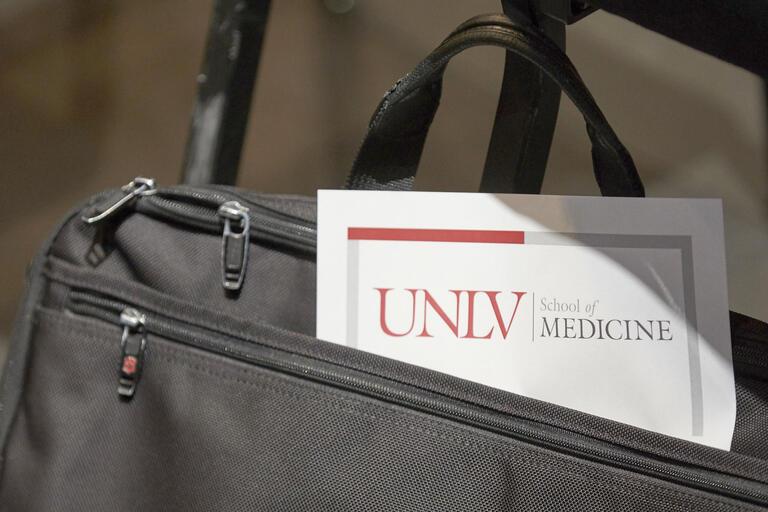 briefcase with UNLV School of Medicine paperwork