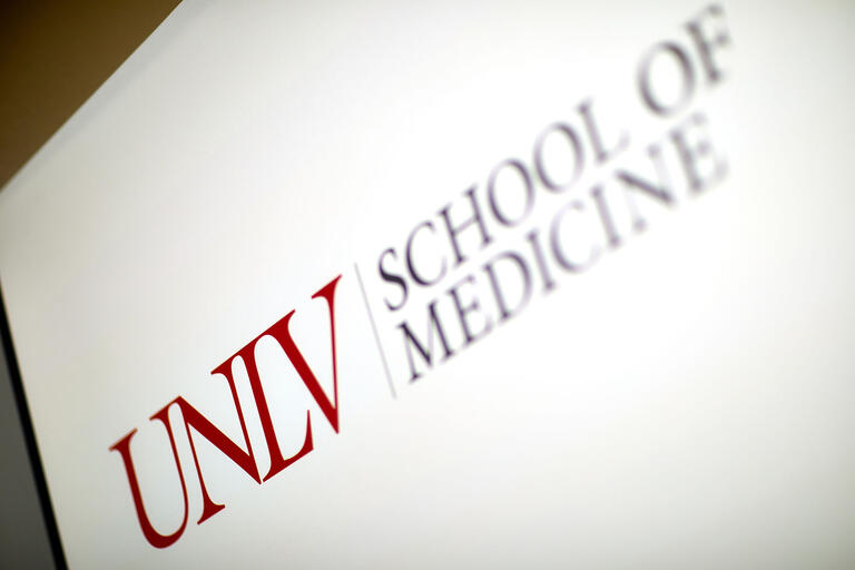 "a sign reading ""UNLV School of Medicine"""