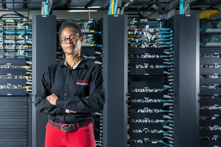woman posing in server room