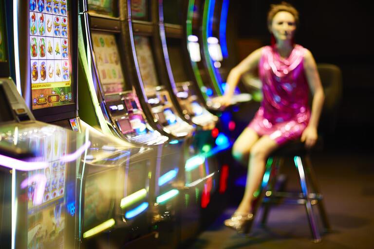 woman leaving slot machines