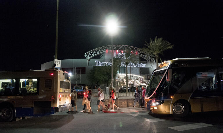 Victims of the Route 91 attack load onto buses