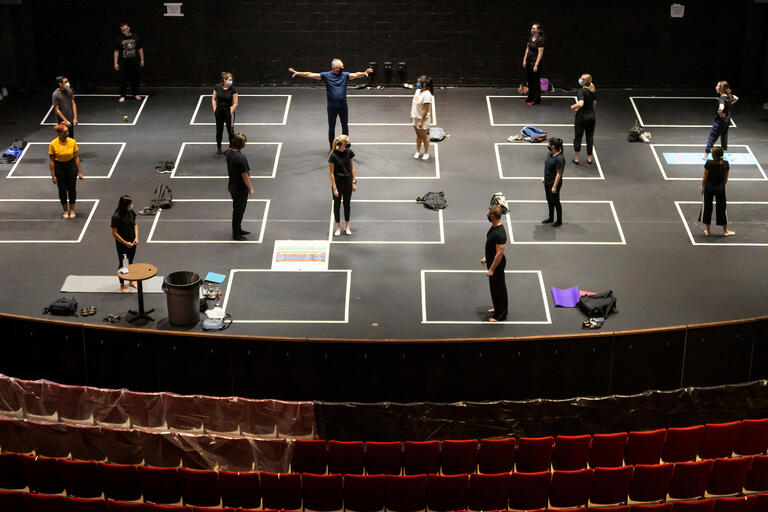 Theater students practice on stage
