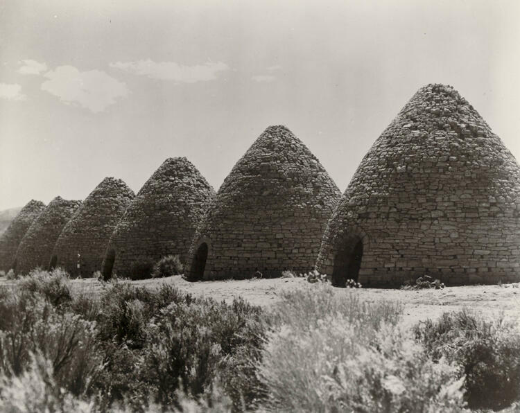 Historic site of charcoal ovens in a field.