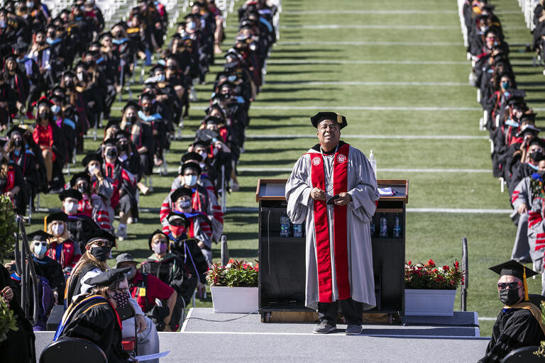graduates at outdoor commencement