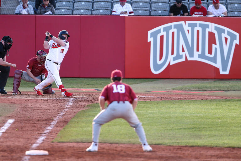 The first baseman readies to make a play as a UNLV batter takes a swing