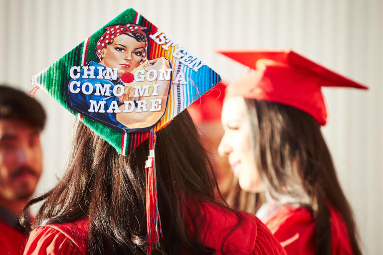 "commencement cap saying ""1st Gen Chin Cona Momo Mi Madre"""